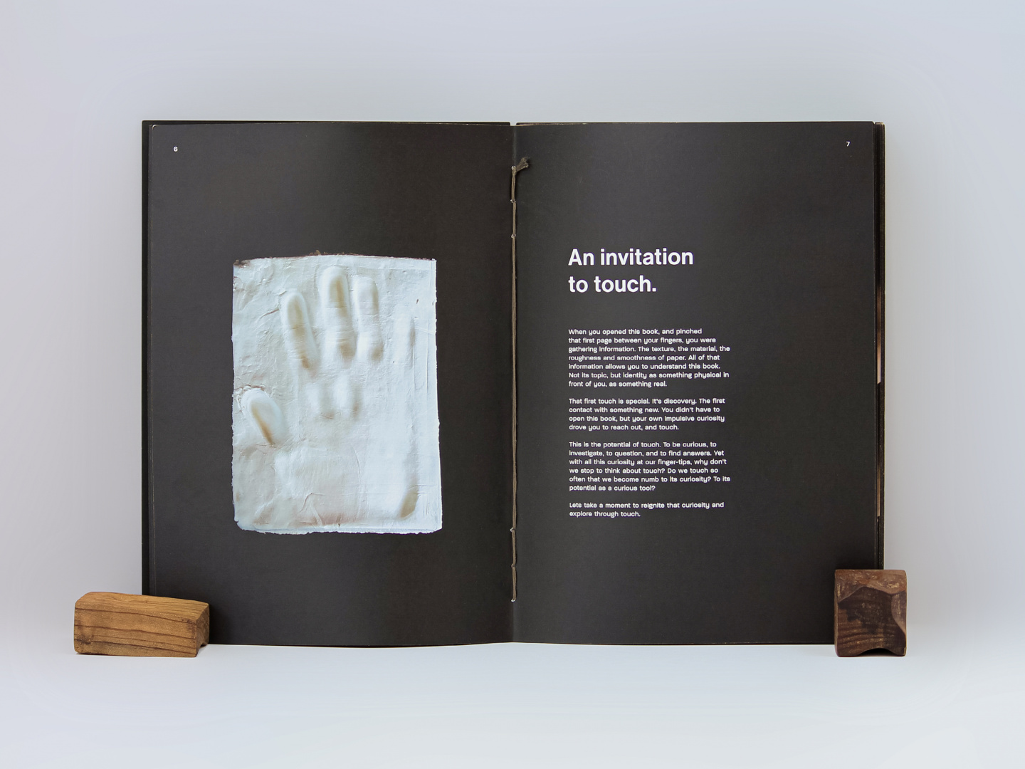 a photo of a book with black pages propped up to face the viewer.